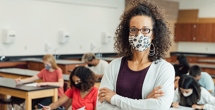Teacher with mask in classroom