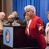 Rep. Grace F. Napolitano speaking at a podium.